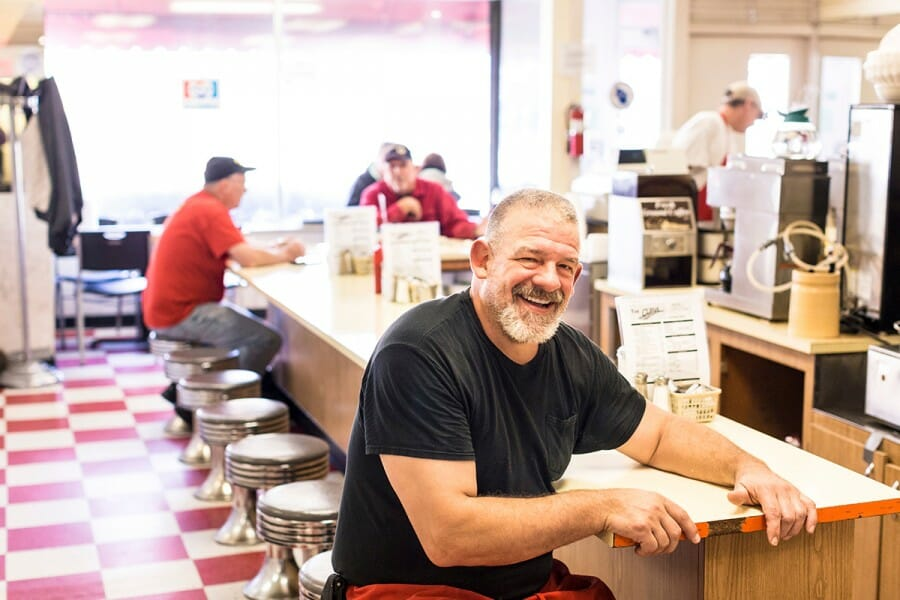 Bill Antonie seated at counter at The Curve