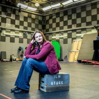 Rachel Rose sits on crate in production room at Industrial Light and Magic studio