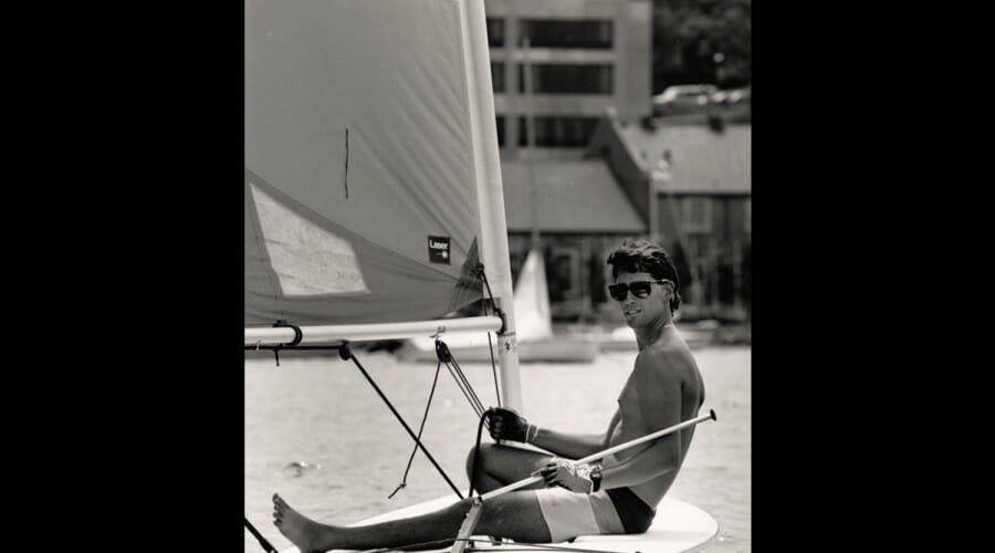 In 1988, a student relaxes on a laser boat, a quick and agile addition to the Hoofers fleet.