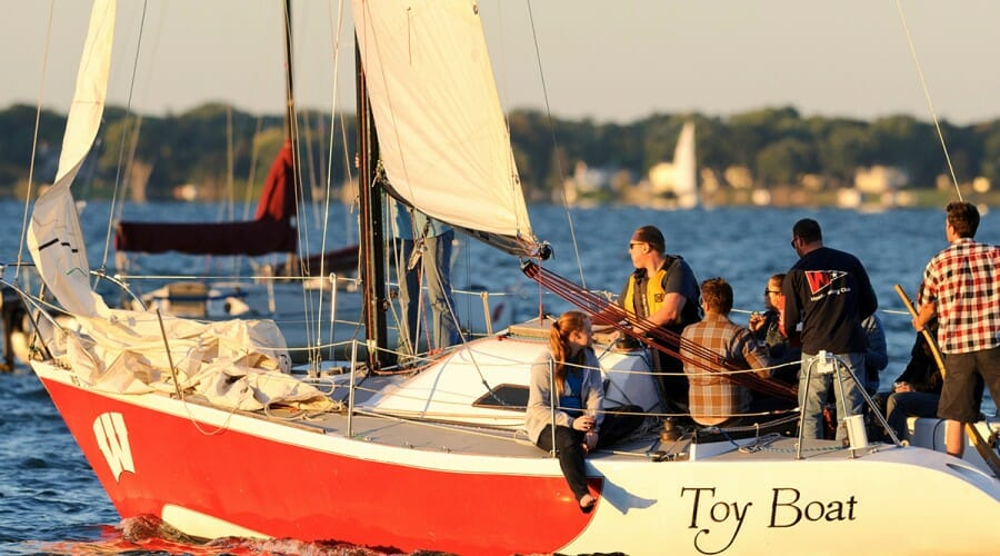 Members of the UW Hoofer Sailing Club head out from the University of Wisconsin–Madison shoreline to enjoy a sunset sail on Lake Mendota