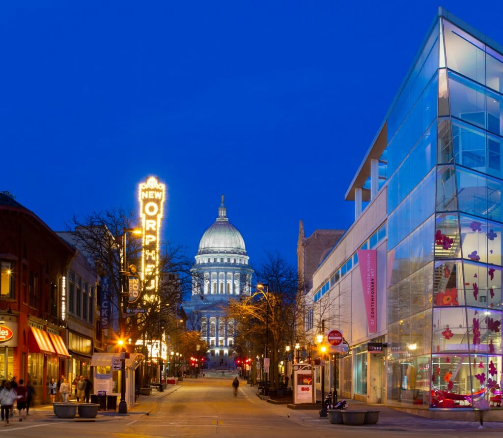 Nighttime view of the capitol building and State Street in Madison, WI.
