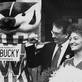 Tommy Thompson with UW Badgers cheerleader and Bucky Badger mascot