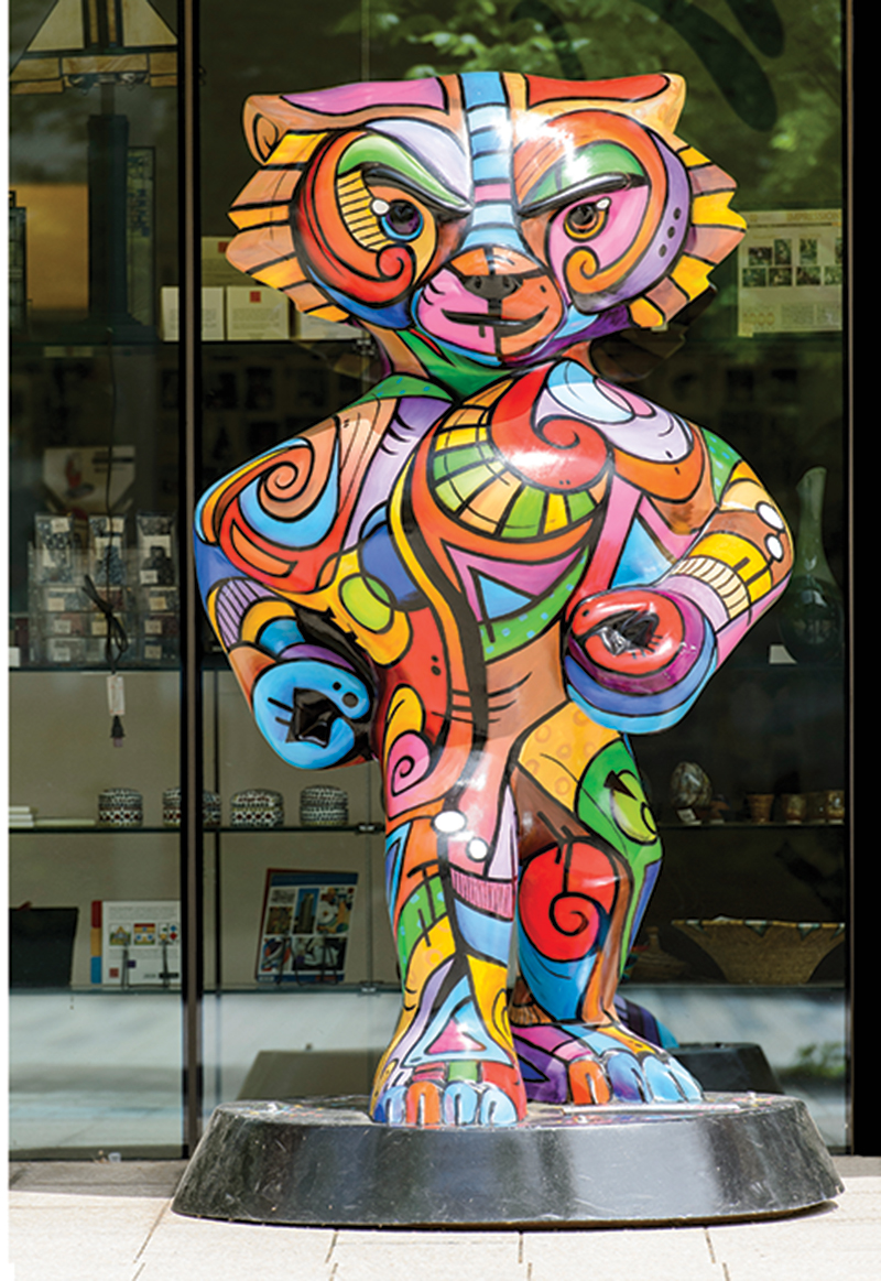 Bucky statue painted with Picasso-like abstract designs