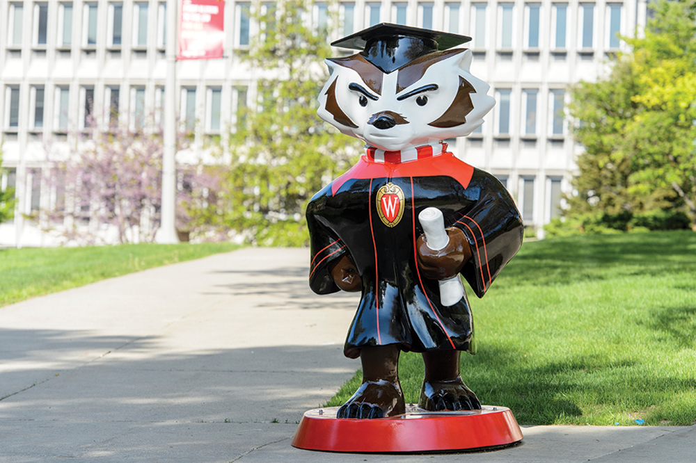 Bucky statue wearing graduation uniform