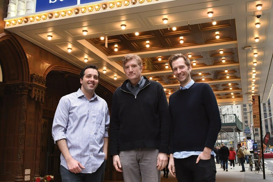 Brian Stack stands with Aaron Cohen and Gabe Gronli, outside a theater with a sign for the Late Show on its marquee