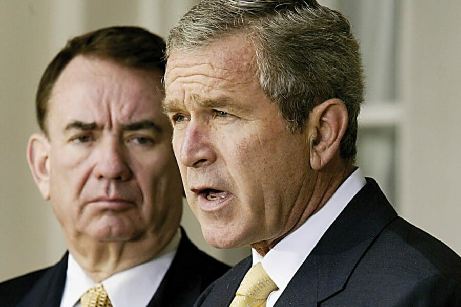 Tommy Thompson alongside President George W. Bush
