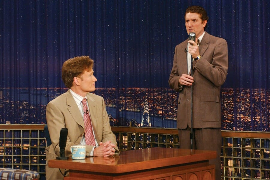 Brian Stack performs a skit with Conan O'Brien