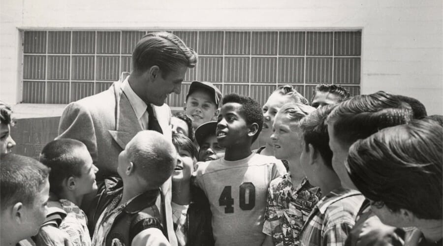 Elroy Hirsch greets a group of children