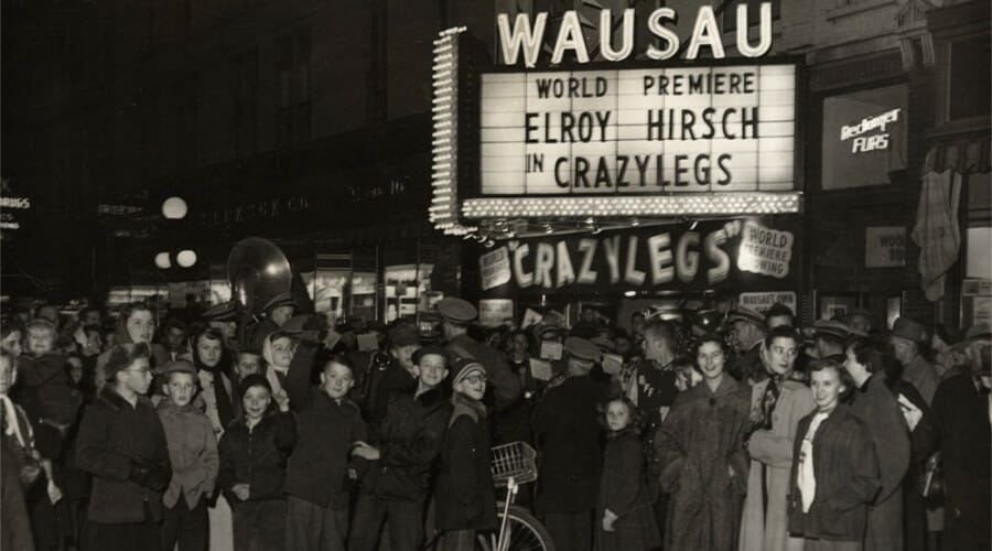 A crowd gathers outside the movie theater in Wausau, Wisconsin, for the premiere of Crazylegs in 1953.
