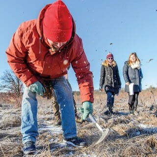 Douglas Rouse and his students collect frozen soil samples in the UW Arboretum.