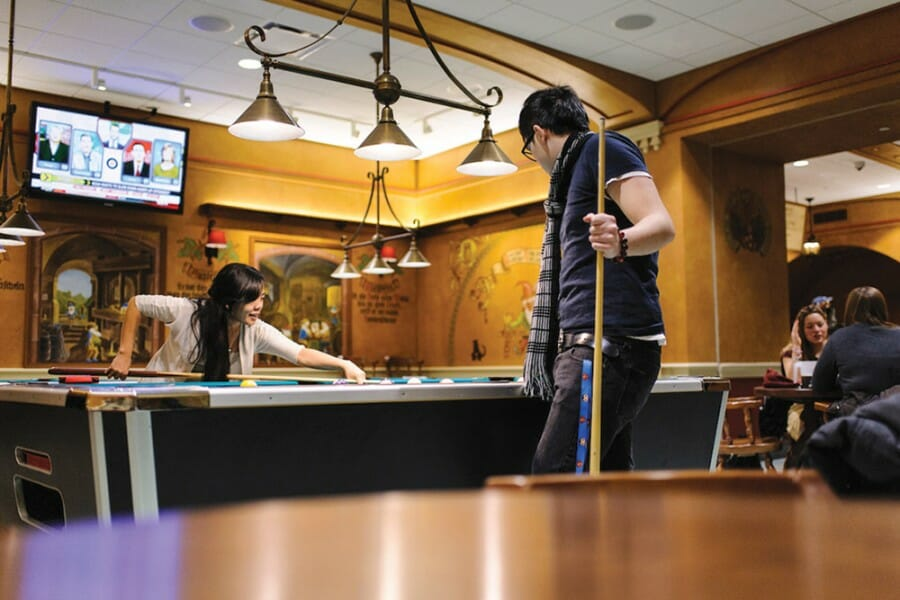Two students play pool in the Memorial Union Der Stiftskeller