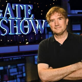 Brian Stack stands on set of The Late Show