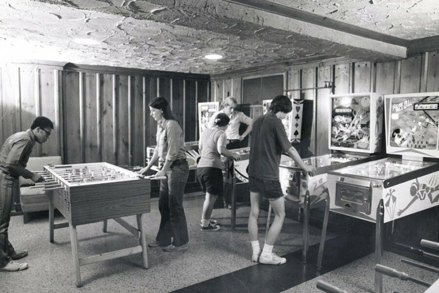 Black and white photo from the 1970s of students playing foosball