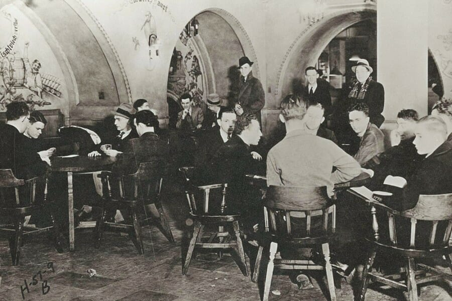 Historical black and white photo of students playing cards in the Memorial Union