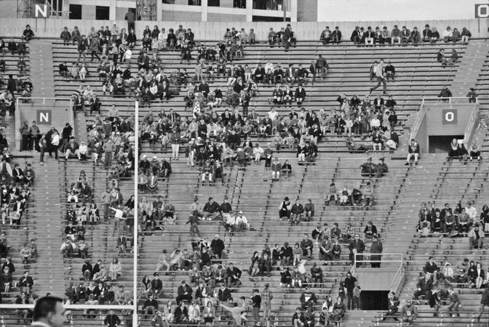 Black and white photo showing students in stands at 1968 Badger football game