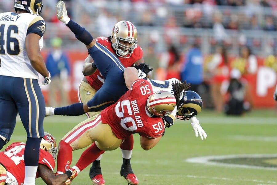 Chris Borland being tackled during football game