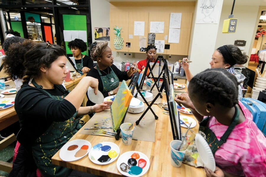 Students paint canvases in the Wheelhouse Studios at UW–Madison