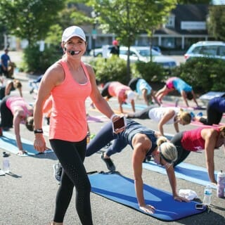 Chris Linehan Freytag leads outdoor yoga class