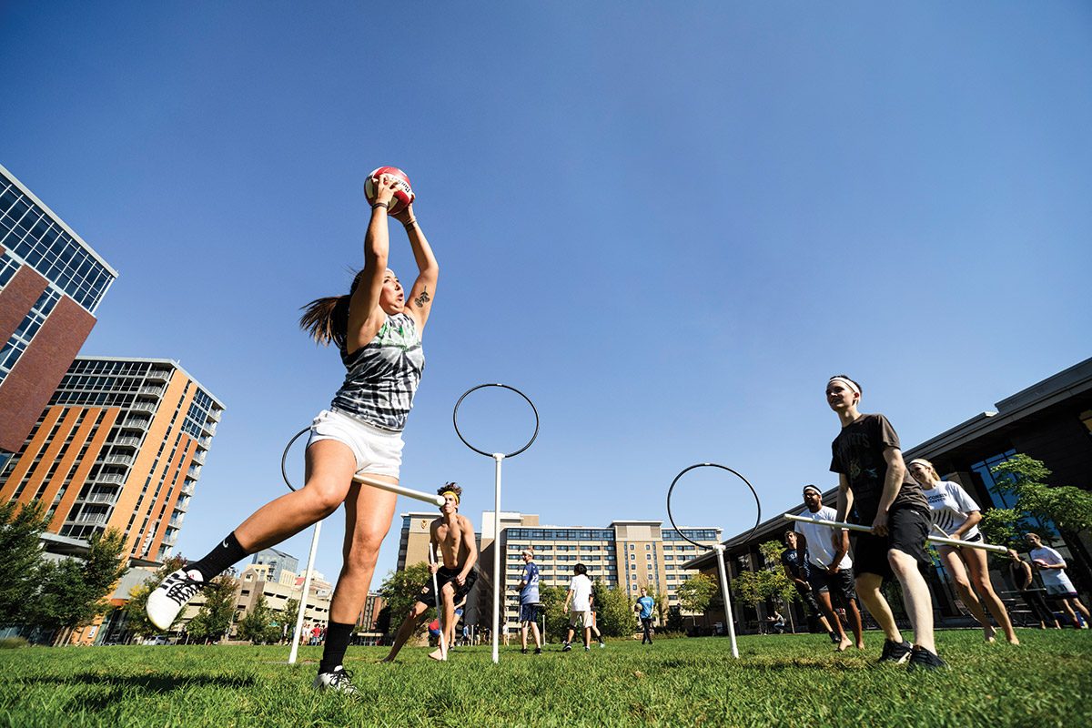 Alison Pujanauski has the ball during a game of Quidditch with fellow students