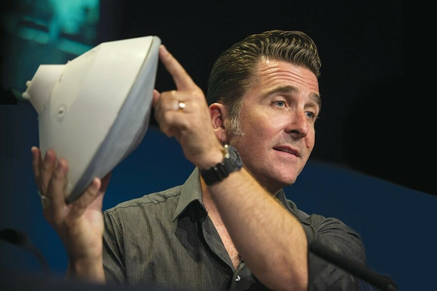 Adam Steltzner holds a model of the Mars entry capsule