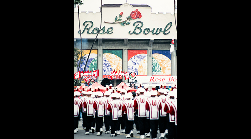 Members of the UW Marching Band stand outside the Rose Bowl Stadium