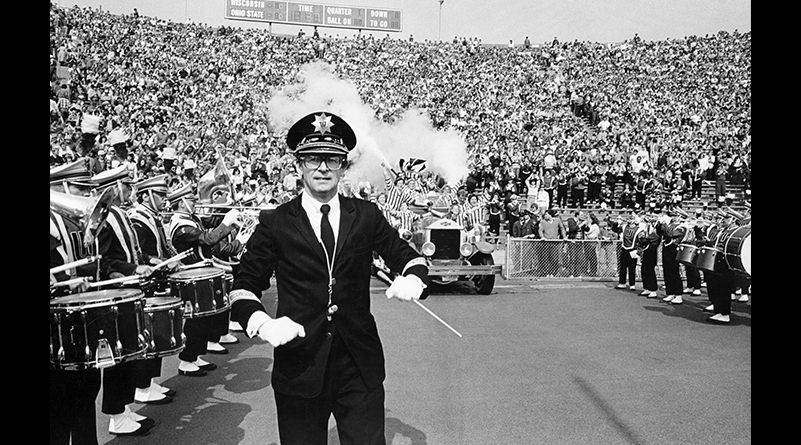 Mike Leckrone with members of the UW Marching Band in formation at Camp Randall Stadium