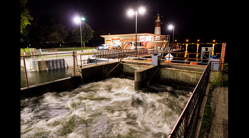 "Water rushes through the Tenney Lock as the flood-stage level of Lake Mendota water threatens the dam along the Yahara River on the night of August 30. Said the Madison city engineer Rob Phillips: ""If the Tenney Dam were to fail"" — albeit unlikely — ""we would have a catastrophic event."""