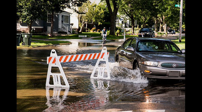 A road hazard sign warns of high-standing water flooding West Shore Drive along Monona Bay on September 6.
