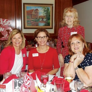 Renee Tuzee '88; WAA Chief Alumni Officer Sarah Schutt; Virginia Porter '58, MM'60; and Lea Davis enjoyed dinner at the Orange County Founders' Day