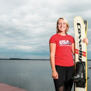 Gabbie Taschwer poses in front of Lake Mendota holding her water skis.