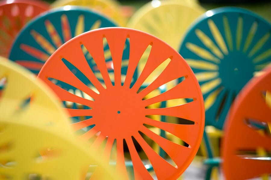 Close-up of yellow, green, and orange sunburst chairs at the Un