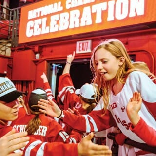 UW women's hockey team high-five fans