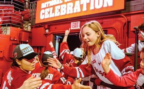 UW women's hockey team high-five fans