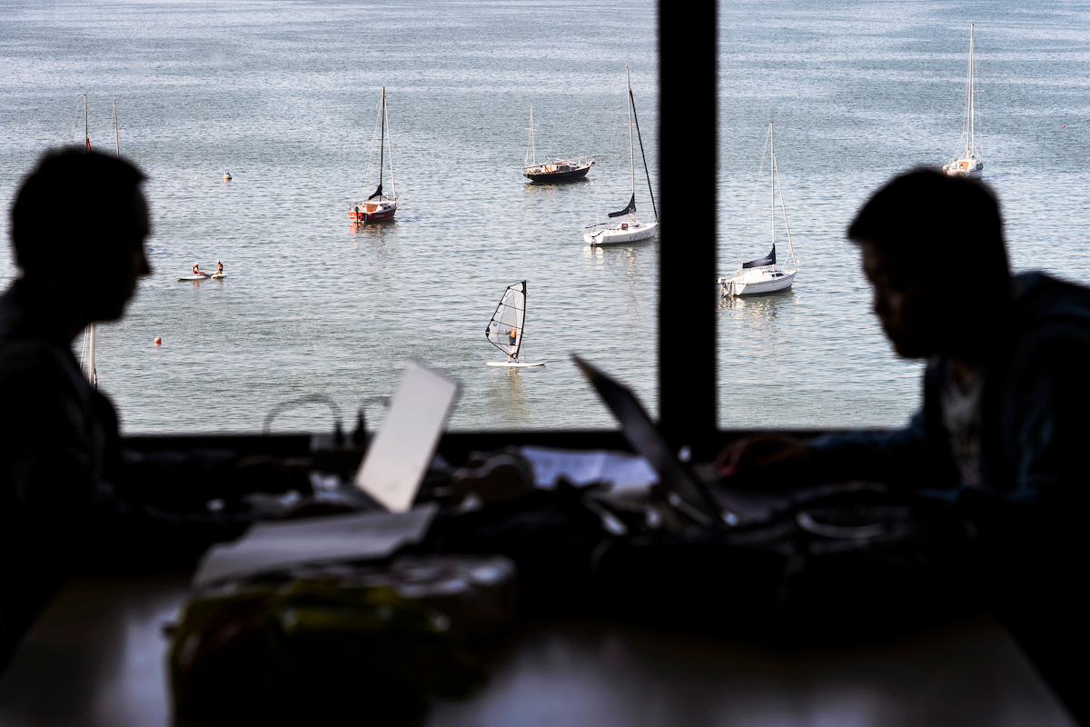 View out of one of the windows in Helen C. White hall shows sailboats on Lake Mendota