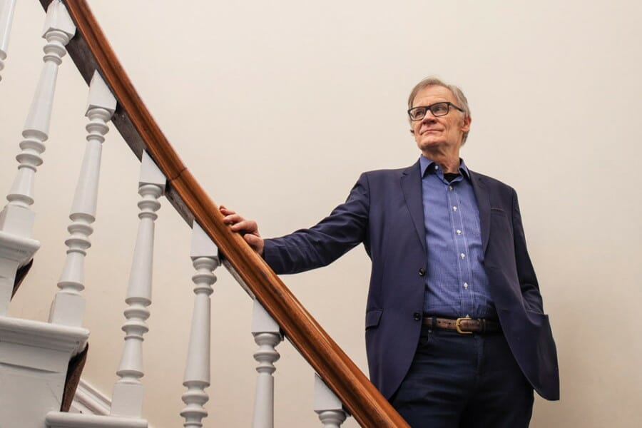 David Blight poses on staircase