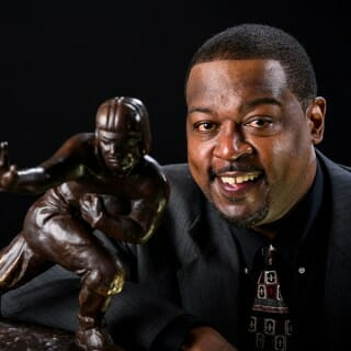 Ron Dayne poses with Heisman trophy