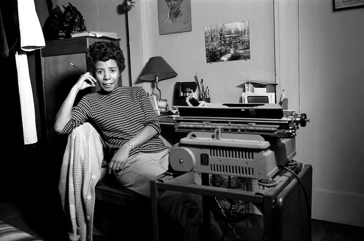 Lorraine Hansberry poses with her typewriter at her Greenwich Village apartment in 1959