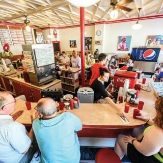 Patrons sit at counter at Mickie's Dairy Bar