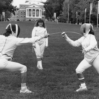 Black and white photo of women fencing on Bascom Hill
