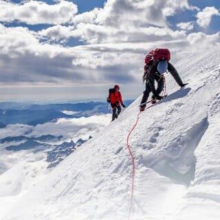 Hikers on a snowy Mount Rainier