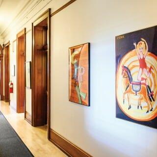 Bascom Hall hallway lined with paintings