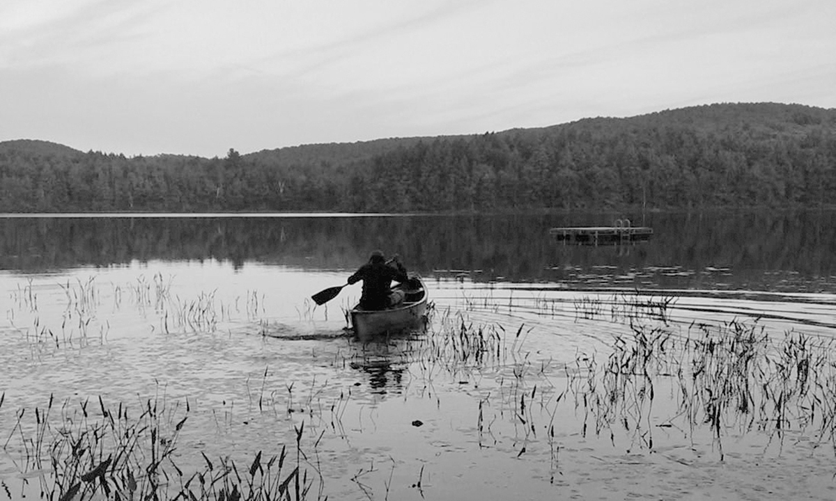 David Carr in a row boat at the family's cabin in the Adirondacks