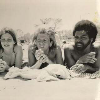 De Shield sunbathing with two friends in 1970