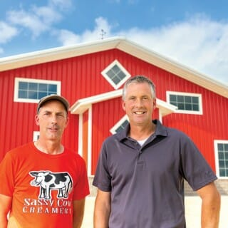 Robert and James Baerwolf in front of a red barn