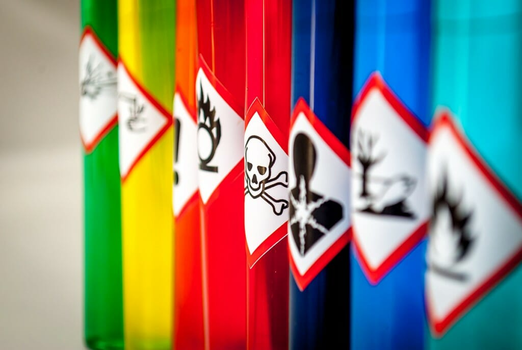 Row of vials labeled with symbols for toxic substances