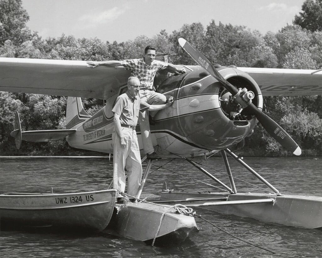 Arthur Hasler and Robert Ragotzkie on the UW's meteorology plane on Lake Mendota