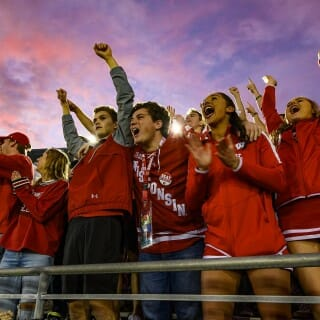 As the sun sets over the stadium, badger fans cheer on the team during the Rose Bowl Game in Pasadena, California on Jan. 1, 2020.