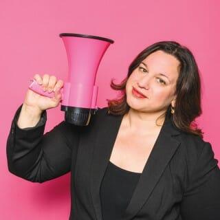 Veronica Rueckert holding a pink megaphone