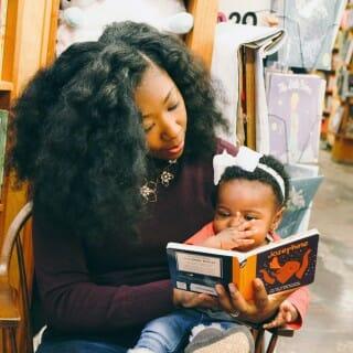 Melanie Kirkwood Marshall reading to toddler