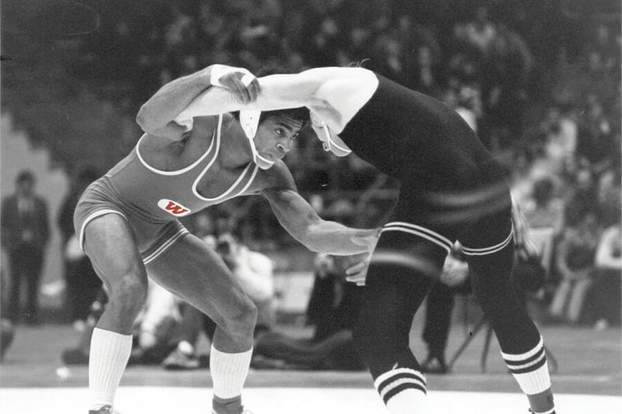 Kemp, above left, wrestled University of Iowa NCAA champion Chuck Yagla in the 1976 East-West Allstar meet, winning 10–4. Just several months earlier, the UW sophomore had beaten Olympic gold medalist Dan Gable at the Field House.